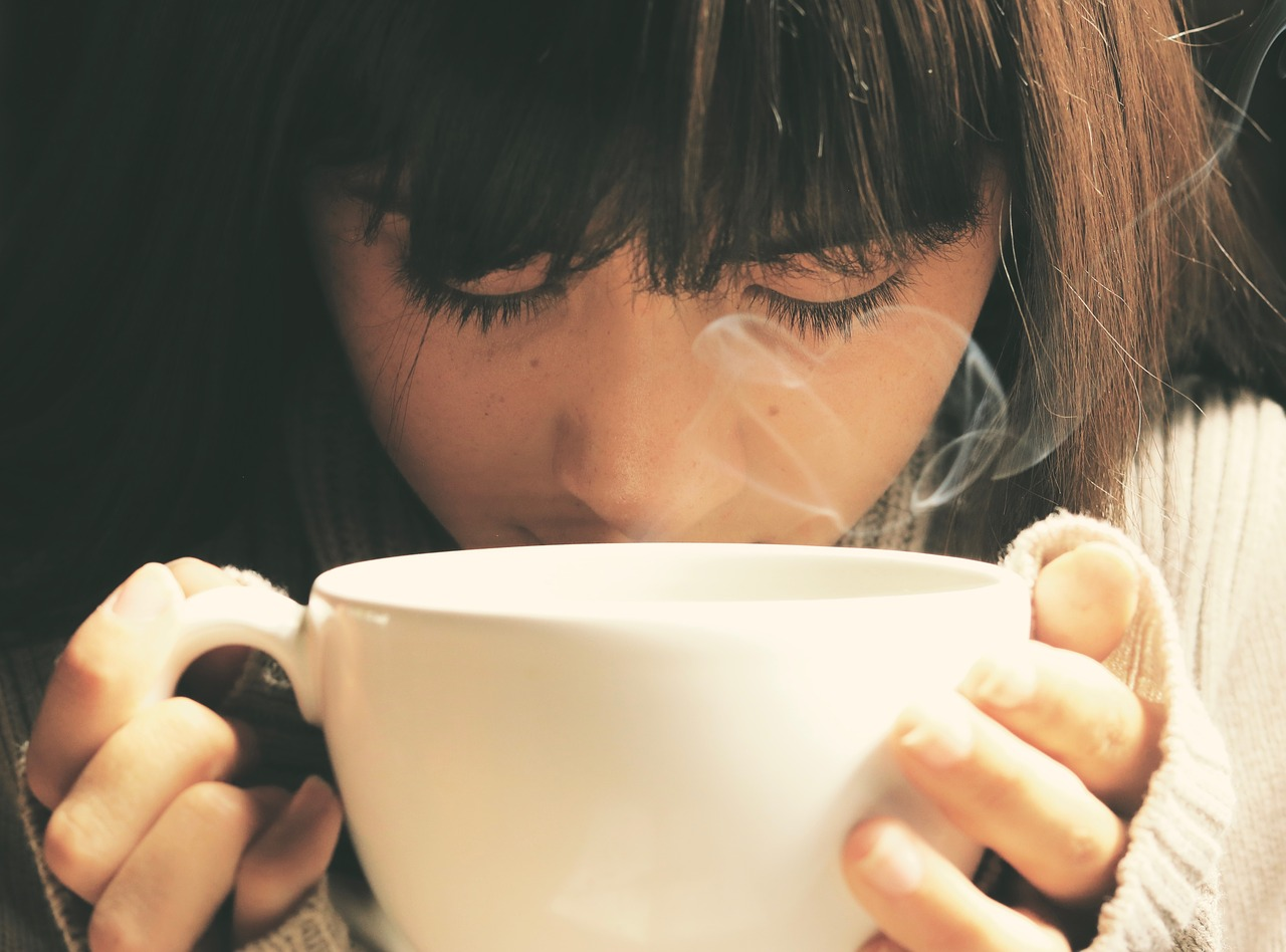 sad woman, drinking tea