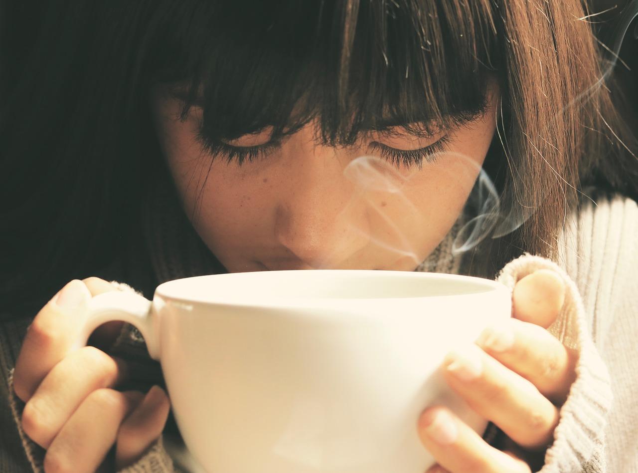 sad woman, drinking tea